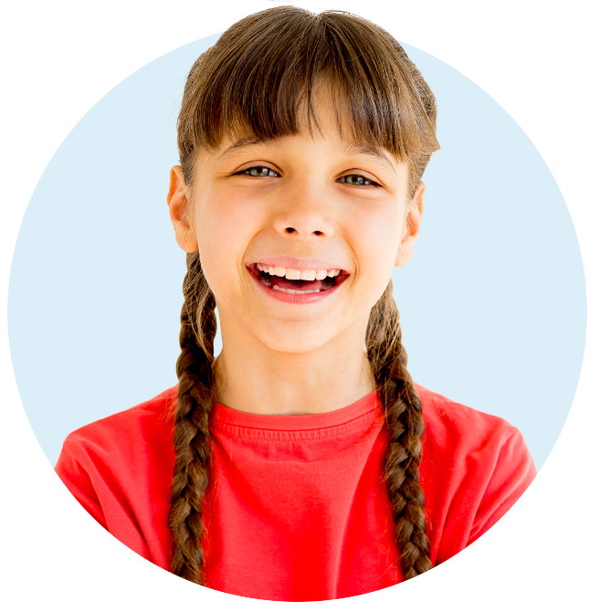Smiling young girl in long braids and wearing a red shirt